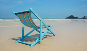 Wooden Chair On Beach